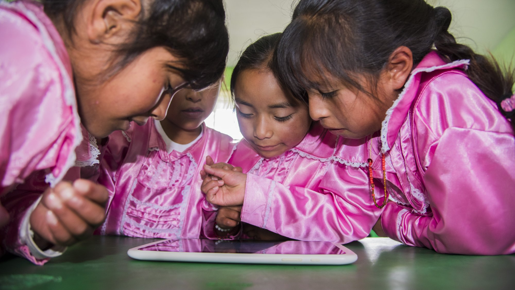 Students of Mazahua background explore learning materials on a tablet at an UNETE-supported school in San Felipe del Progreso, State of Mexico..JPG