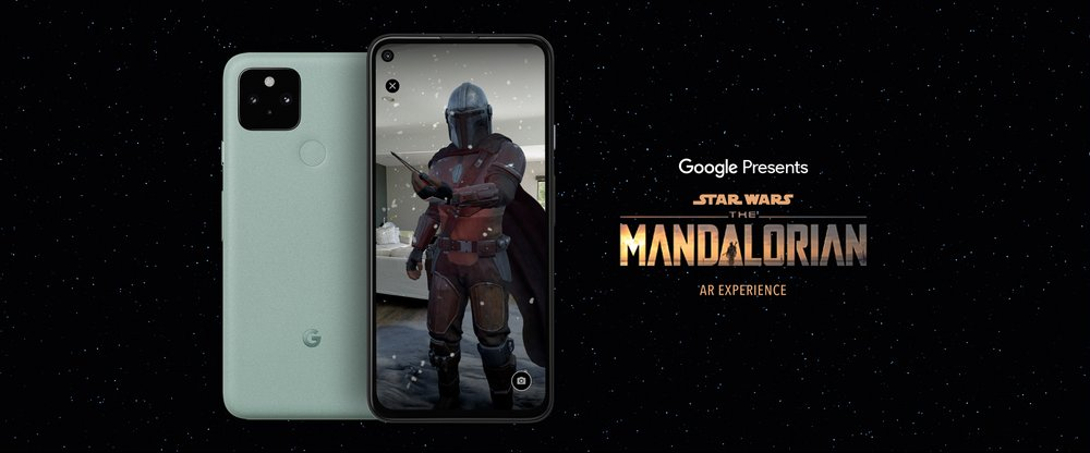 "A Pixel phone against a black background. The screen of the Pixel shows the character the Mandalorian on it. Text on the image to the right of the phone reads ""Google Presents Star Wars The Mandalorian, an AR experience."""
