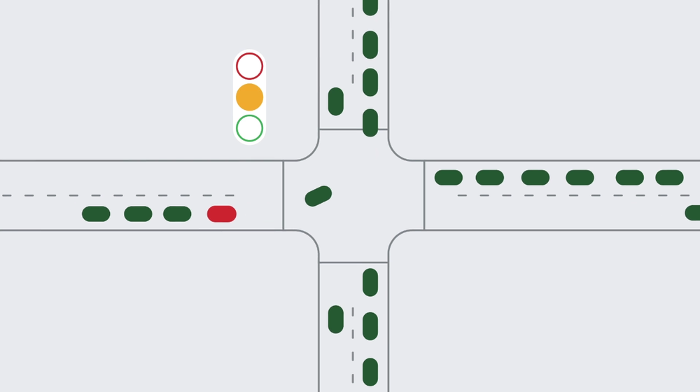Illustration of an intersection showing cars, a stoplight and roadways.