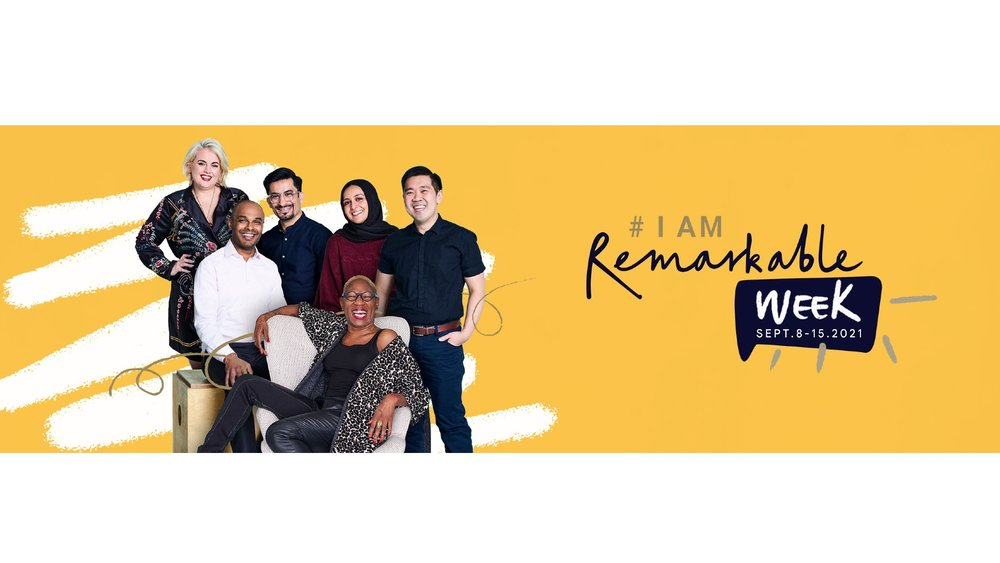 """Image showing six people together, looking into the camera and smiling. The words """"I am remarkable"""" are next to them."""