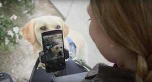 Woman using Voice Access to take a photo of her dog