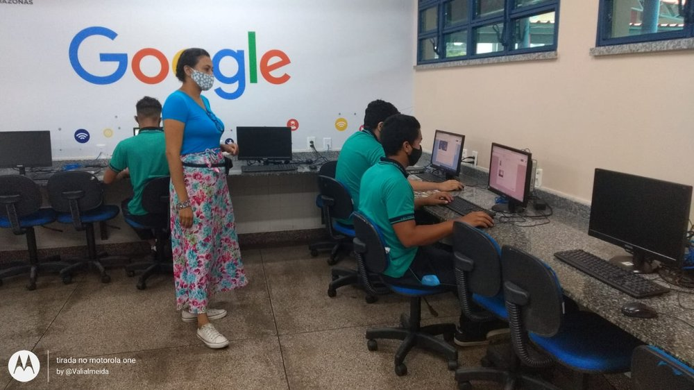 Vanessa teaches her students in a computer lab in Brazil.