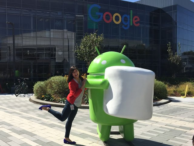 Alison outdoors posing with Android statue at Google headquarters