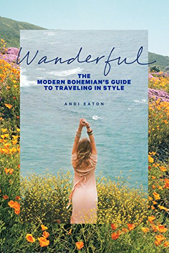 Andi wears a pink dress and raises her arms in a field of wildflowers overlooking the ocean, on the cover of her Bohemian travel guidebook.