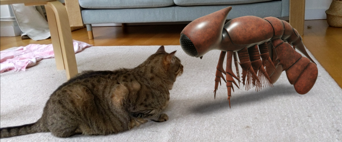 Cat facing an AR creature.png