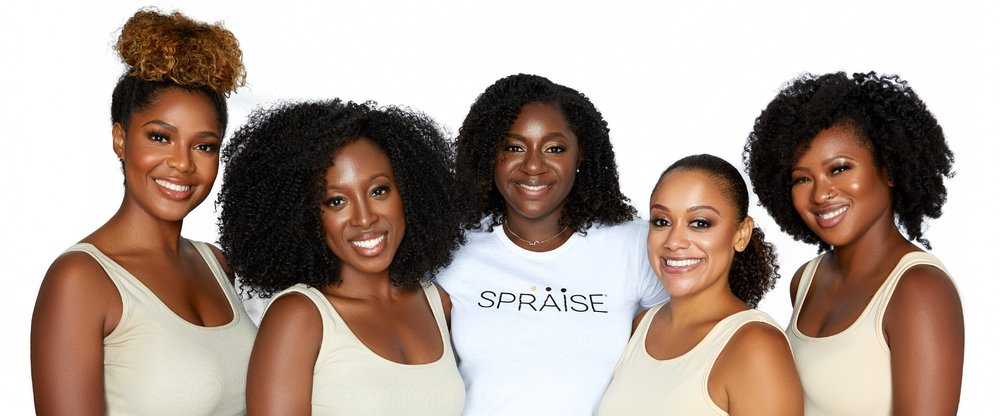 Dominique Boseman in a Spraise shirt with four other women