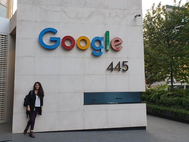 Ana under a Google sign on her first day in the Mexico office.