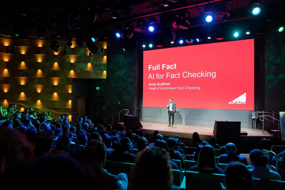 Image of a presentation given on stage about Full Fact and Google.org's work together.