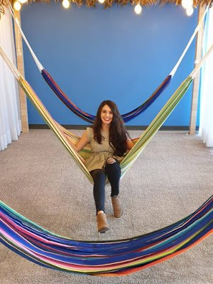Ana sitting in a hammock in the office.