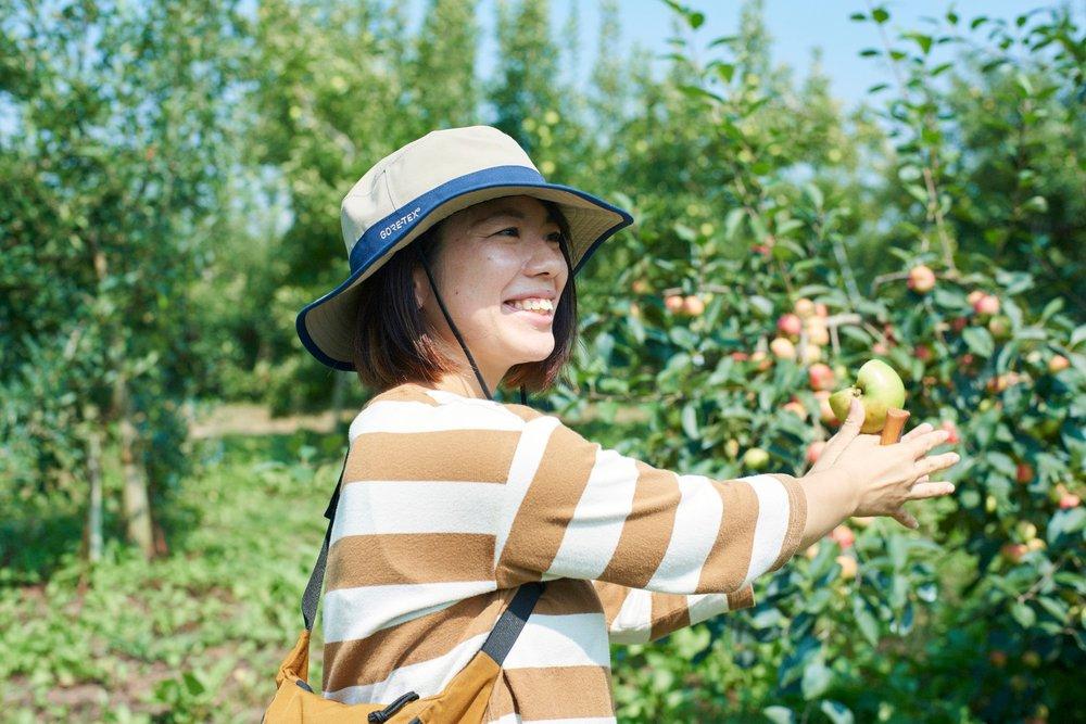 A photograph of Yamashita Fruit Garden CEO, Eri Yamashita, in her orchard
