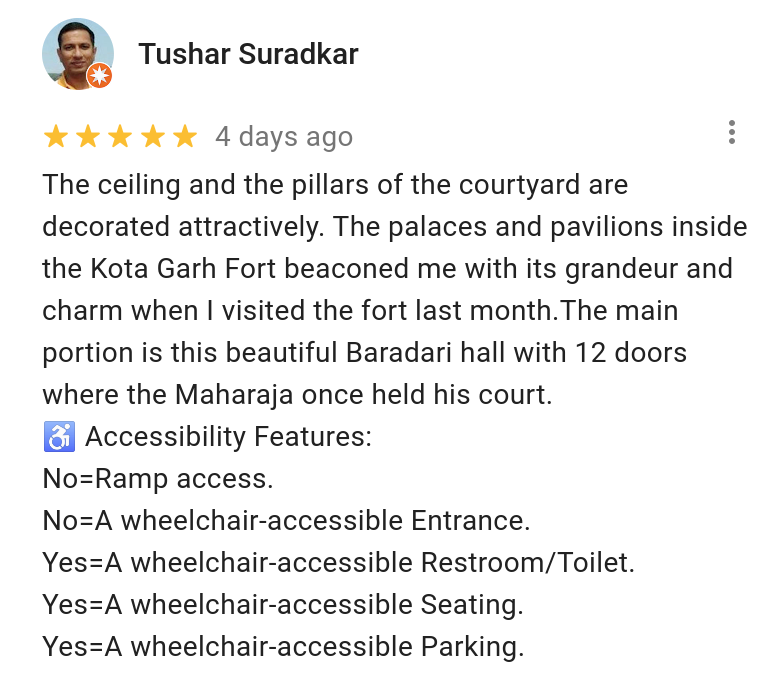 A screenshot of a review on Google Maps from Local Guide Tushar Suradkar showing his accessibility checklist.