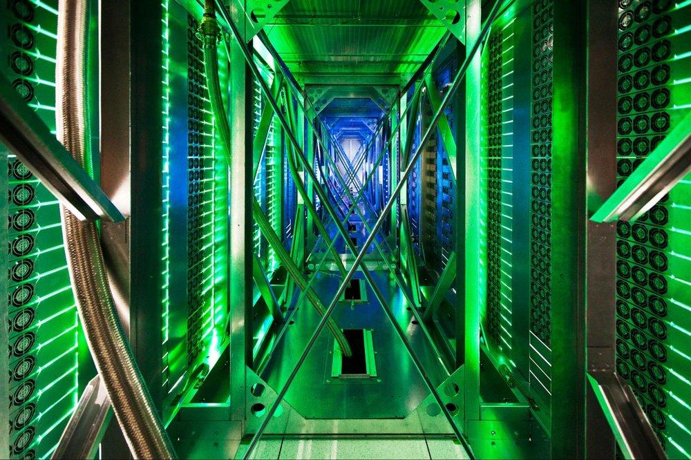 A photo showing green lights inside a Google data center
