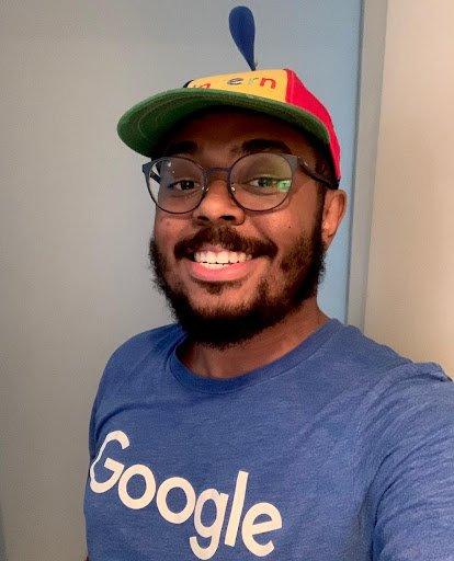 Man smiling with Noogler hat