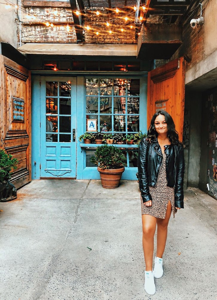 A photo of a female Googler in front of a restaurant