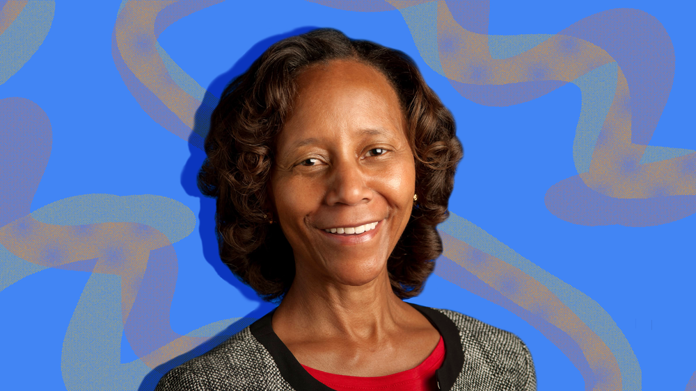 Marian Croak in front of a decorative blue background