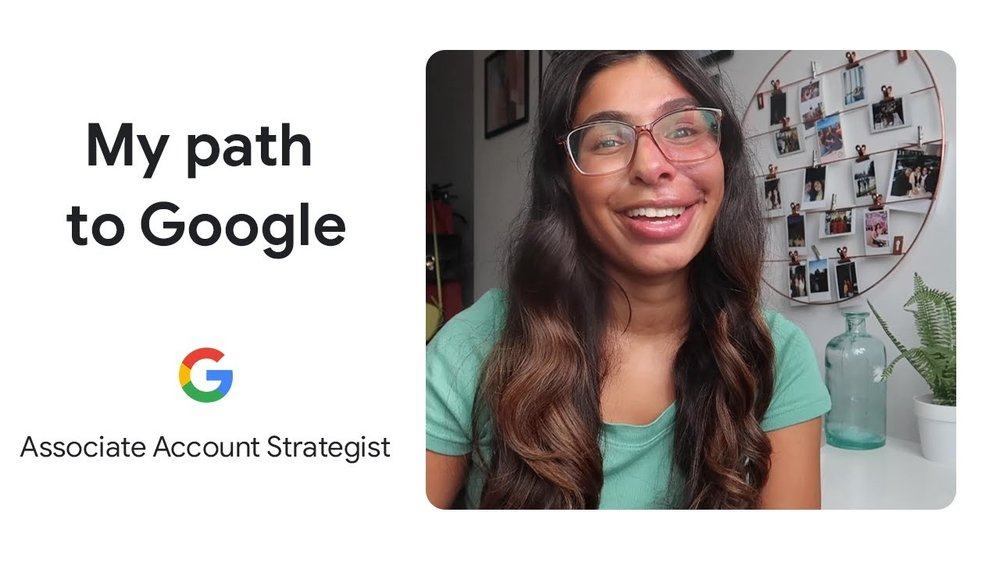 """Screenshot from a video about Prisha's journey to Google. On the left are the words """"My Path to Google"""" and """"Associate Account Strategist"""" with a Google logo above it. On the right is a photo of Prisha smiling at the camera, wearing a teal top."""