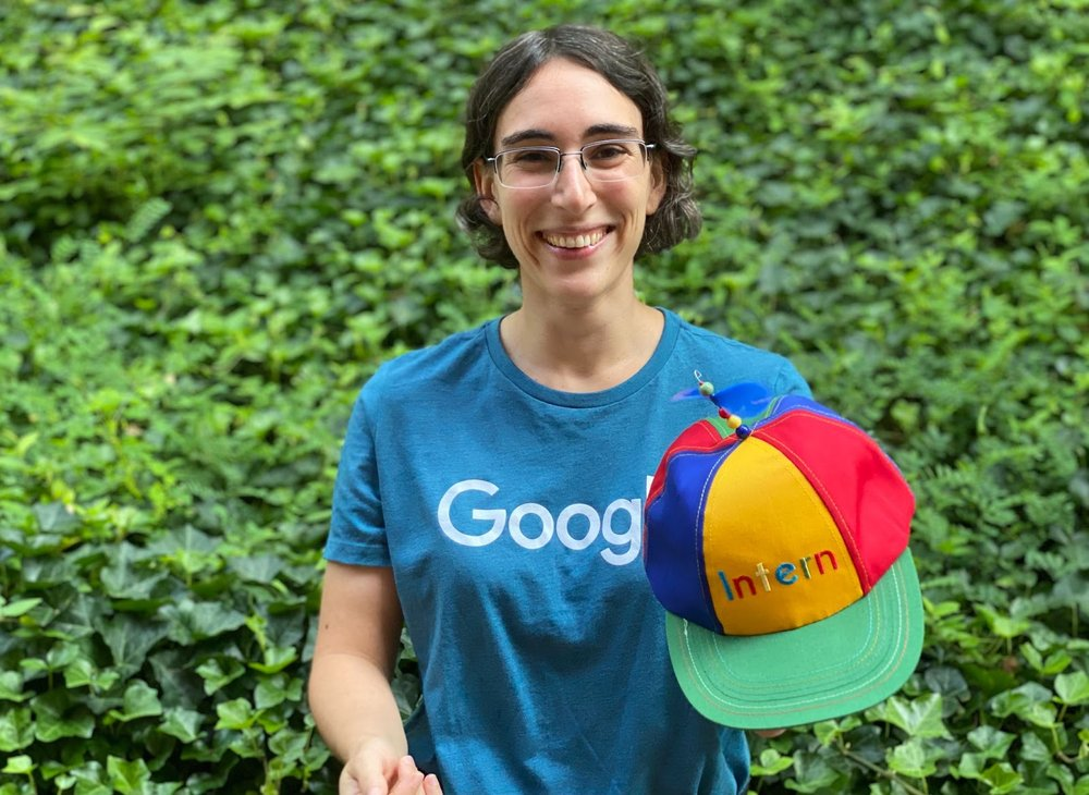Woman smiling with Noogler hat