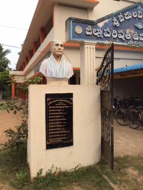 A photo showing a bust of author Suresh Vedula's grandfather outside the community school built on land his family used to own.