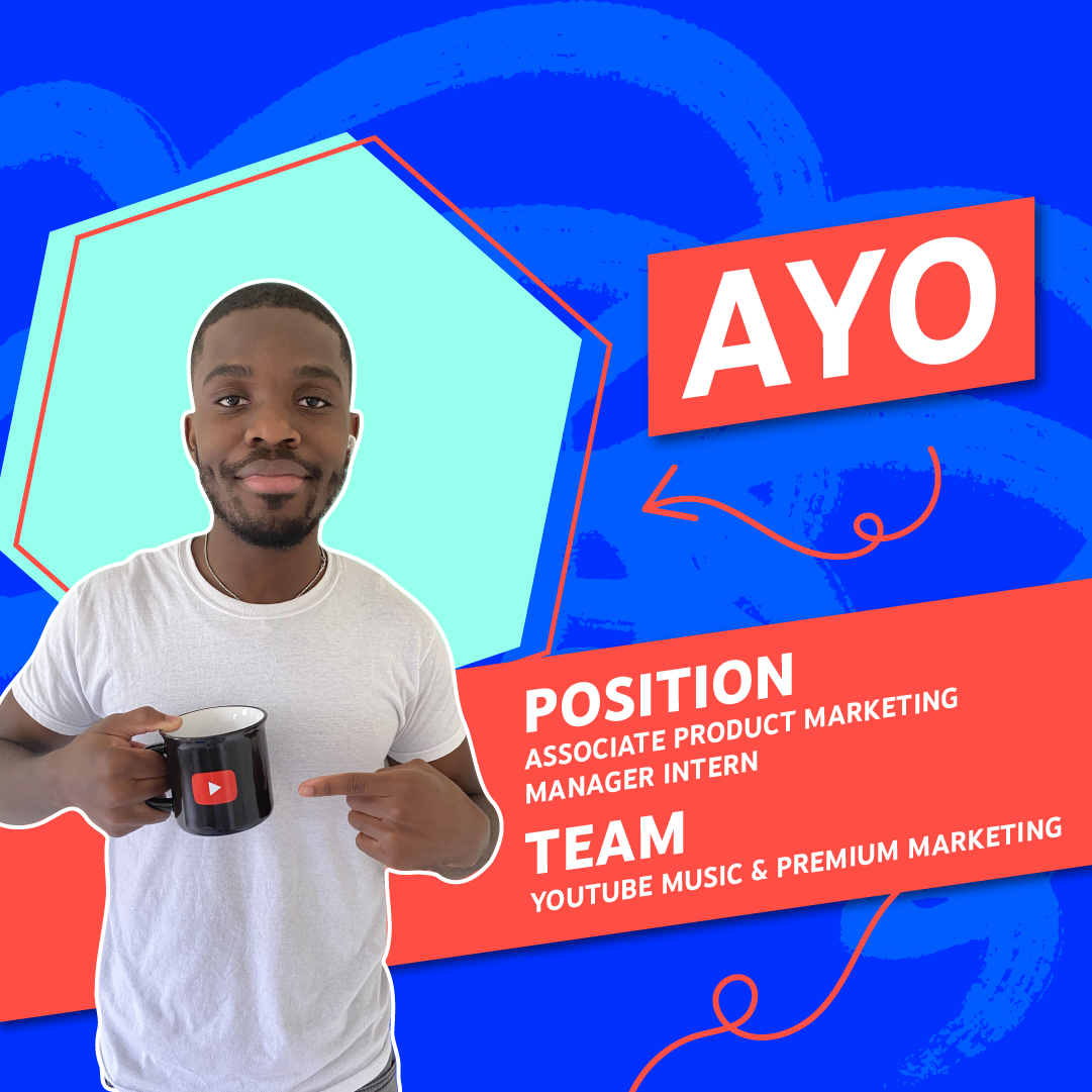 Photo of Ayo pointing to a YouTube branded mug against a patterned background of aqua blue and dark blue