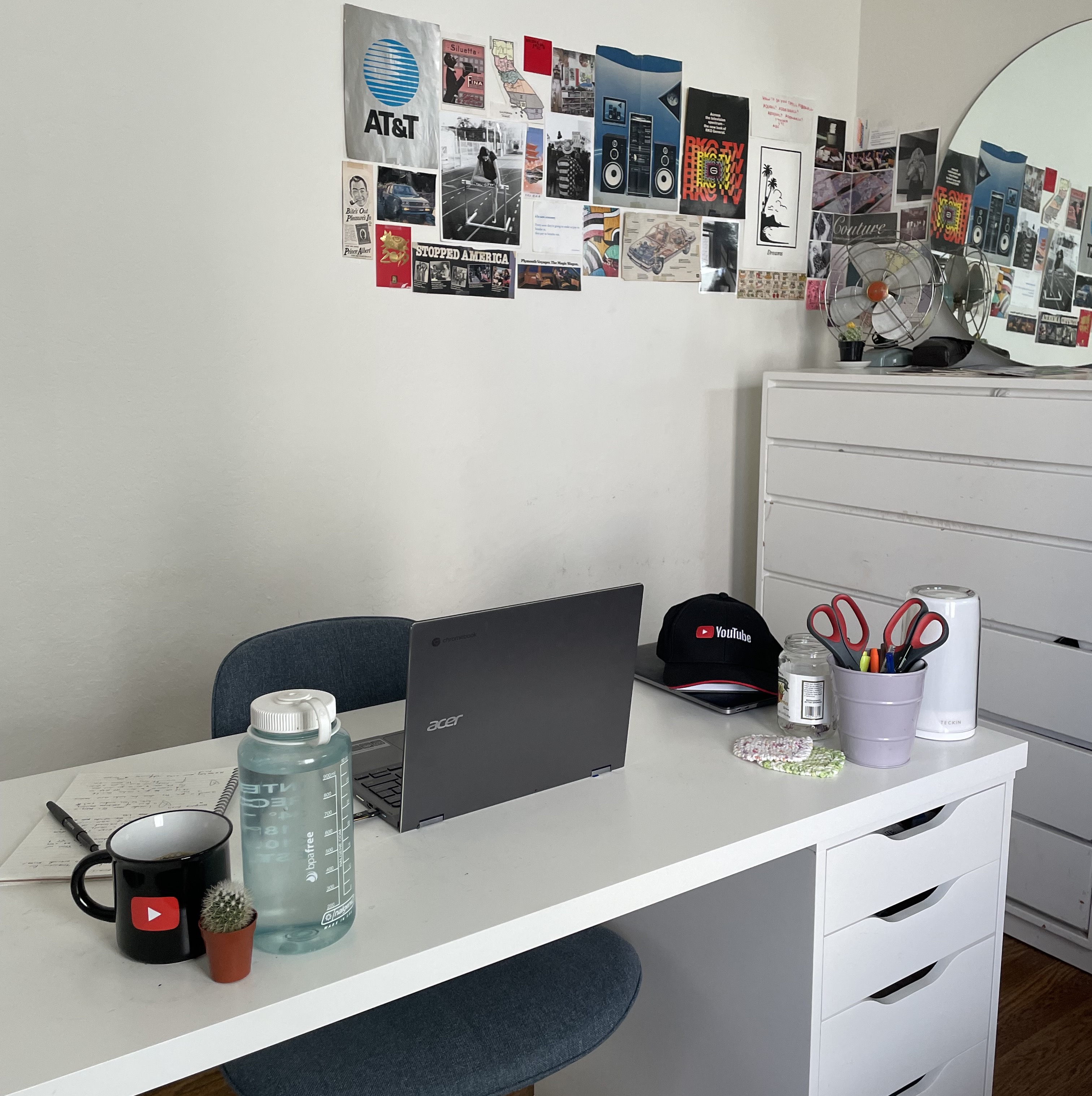 Yasmin's work from home set up with a desk and laptop.