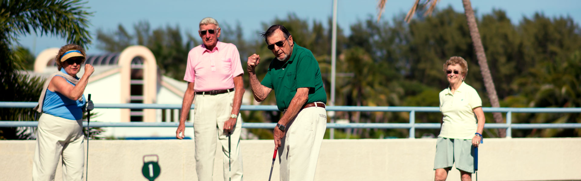 A group of residents playing a round of golf at their retirement community