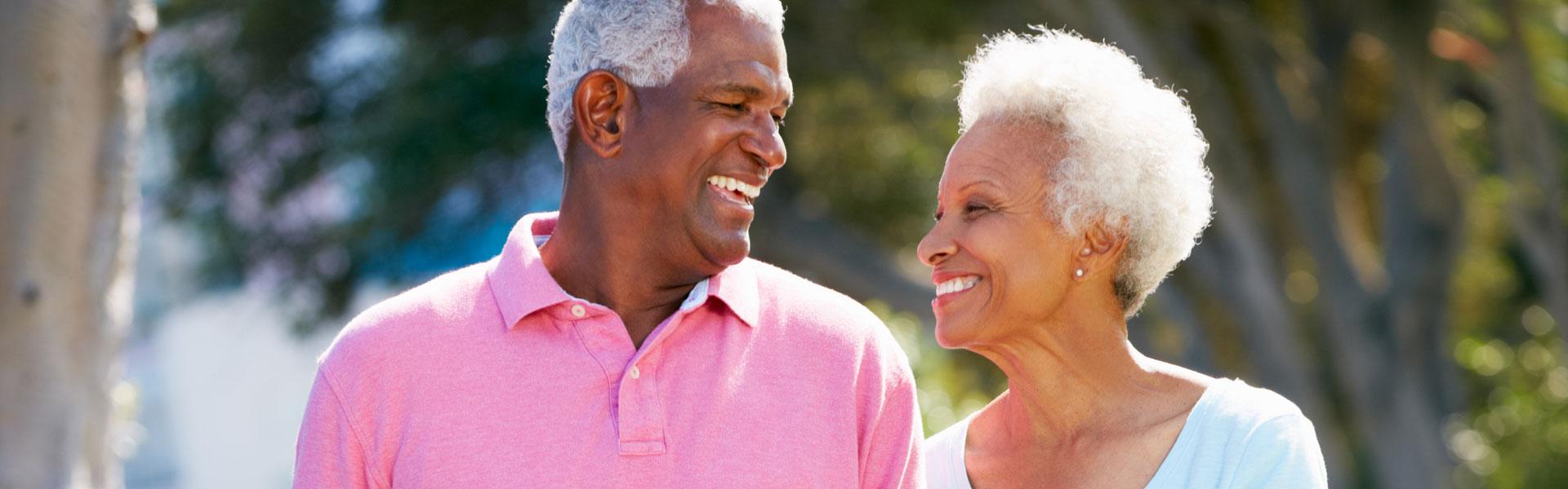An elderly couple walking outdoors