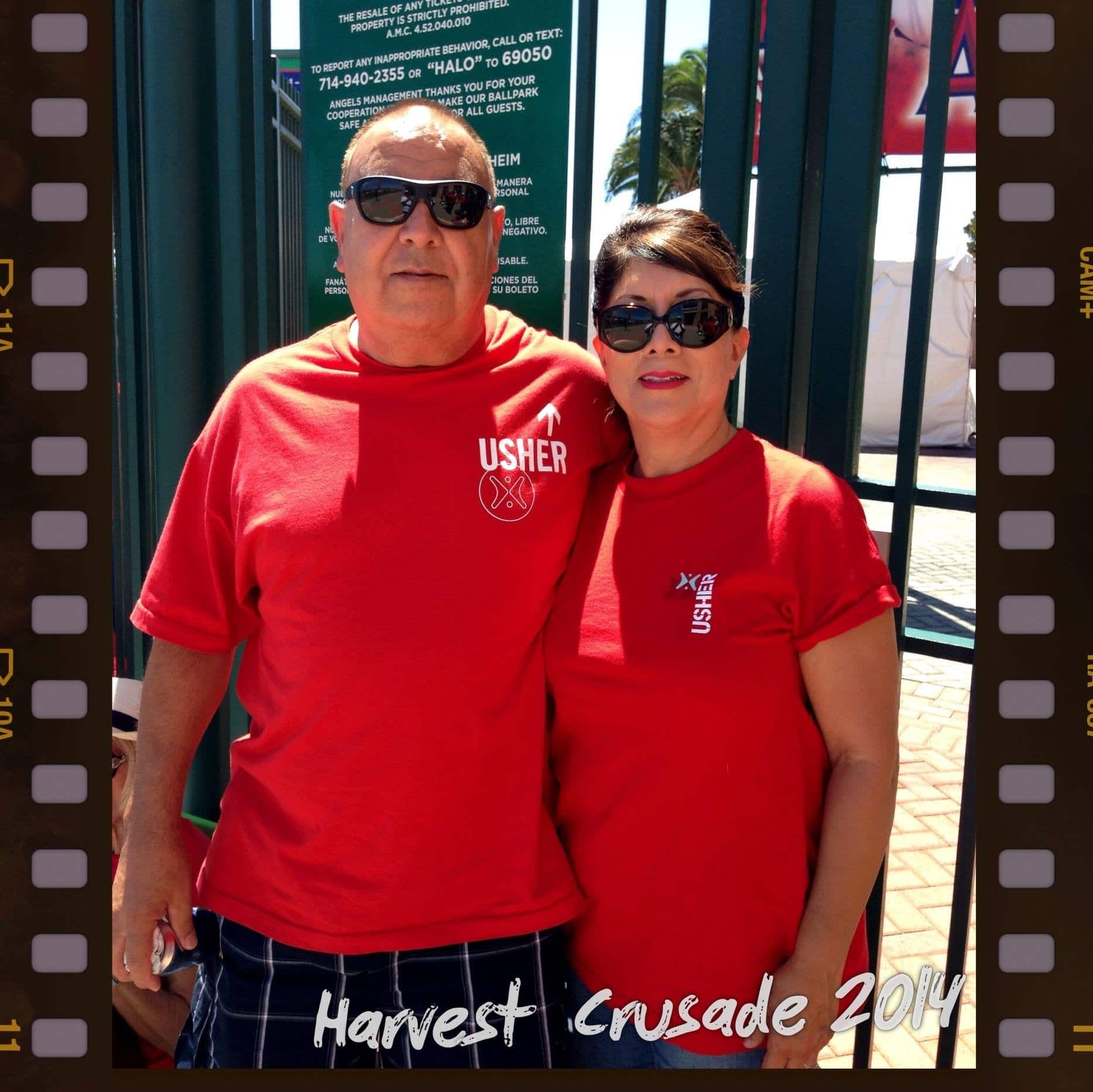man and woman embracing for picture with red shirts outside gate at angels stadium harvest so cal 2019 satruday night