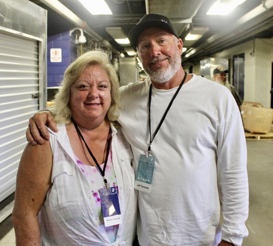 man woman embrace for picture so cal harvest 2019 heart to serve blog