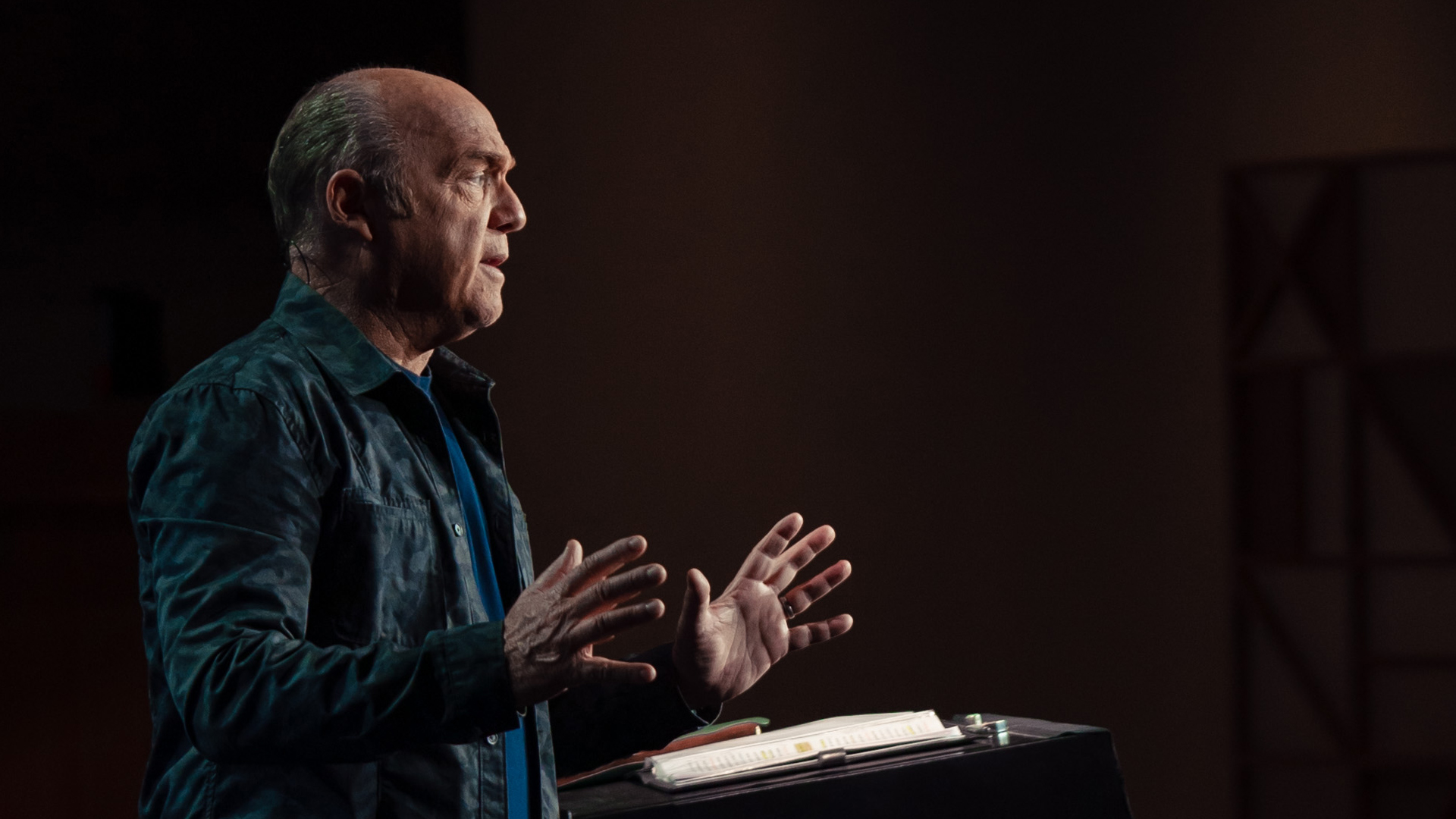 Pastor Greg Laurie preaches at a pulpit