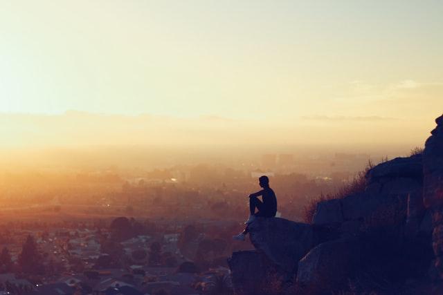 man overlooking a city
