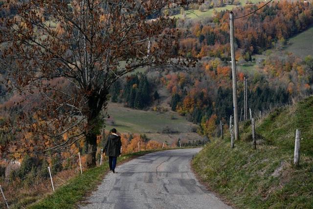 man walking down a path