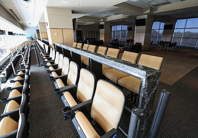 View of empty seats in the McCord Indoor Club at Kinnick Stadium
