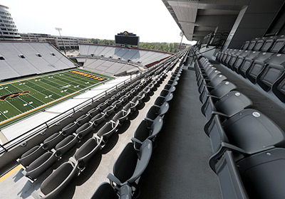 View of empty seats in the Mediacom Outdoor Club at Kinnick Stadium