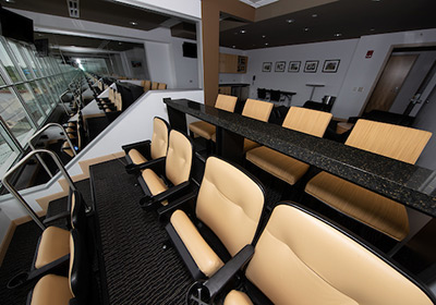 View of seats and the space of a private suite at Kinnick Stadium