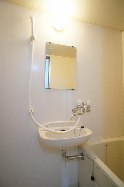 メゾンユキエ 02030号室の洗面所