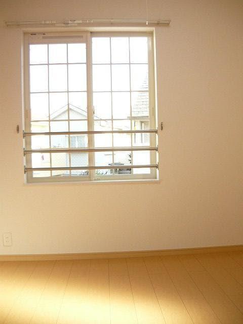 メルヴェィユーパルファンA 01040号室のベッドルーム