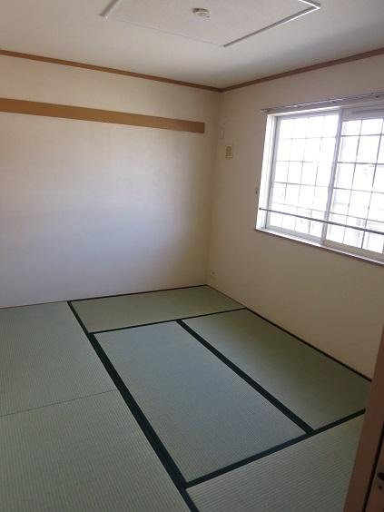 ソレアード B 201号室のベッドルーム