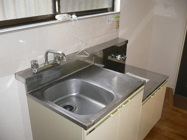 プレサージュ大岡 101号室のキッチン