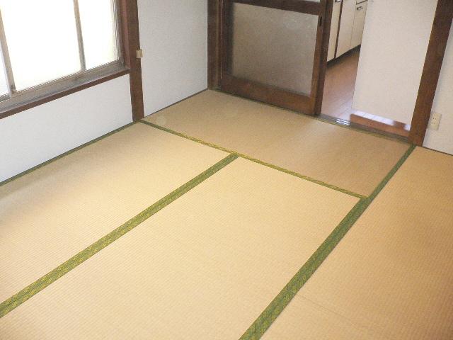 千代松荘 102号室のベッドルーム