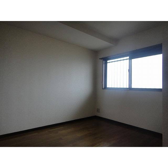 アゼリアコート 404号室のベッドルーム