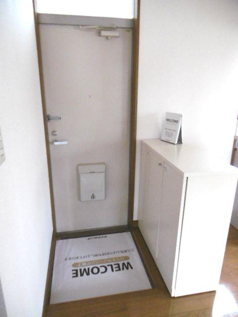 コーポサンフラワー 102号室の玄関