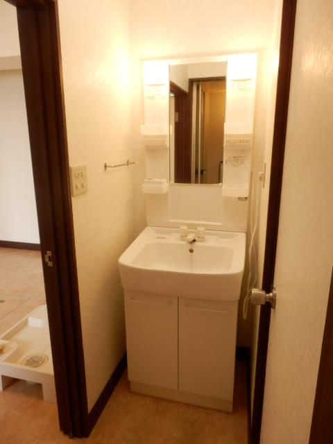 コープ・オリンピア今泉 402号室の洗面所
