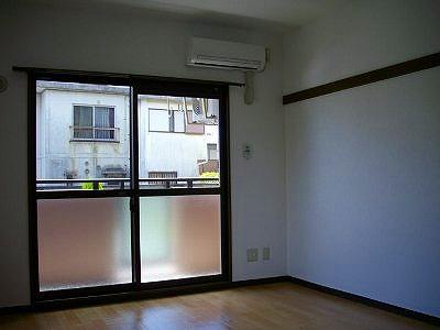 マンションアヤメ 303号室のリビング
