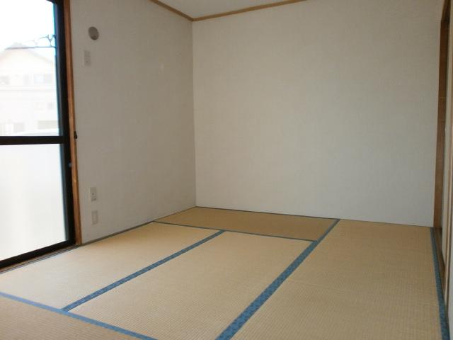セジュールシマダ 201号室のベッドルーム