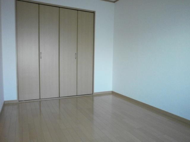 グラン 101号室のベッドルーム