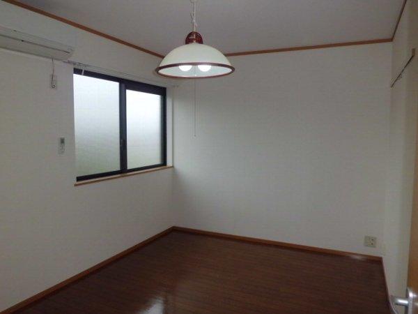 第一ダイソウハウス 201号室のベッドルーム