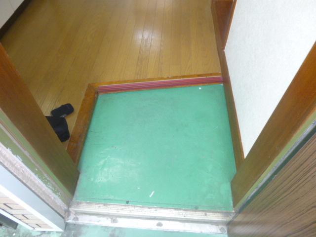 ワンステップ保木間 201号室の玄関