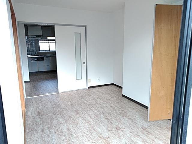 ロイヤルハイツ西沢 203号室のベッドルーム