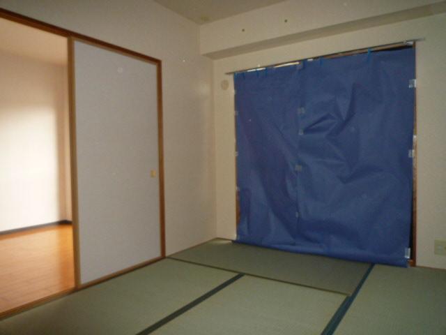 三鈴ライフ 1C号室のベッドルーム