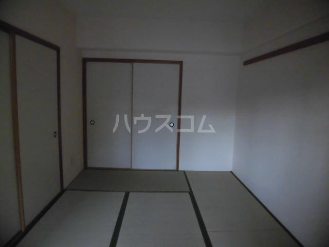 クオーレ 202号室のベッドルーム
